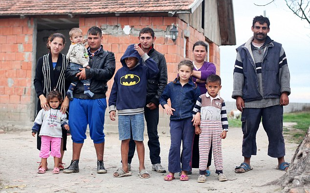 Mass exodus: Remus Neda, far right, his son Simon, third left, who needs drugs for a heart condition and other family members from Berini, Romania