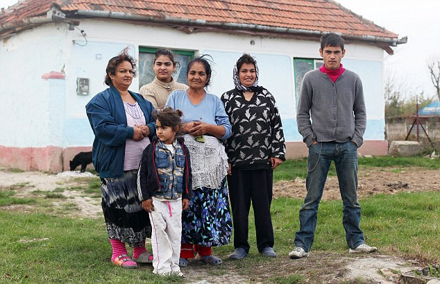 Basic conditions: Daniel Neda, left, and family outside their home