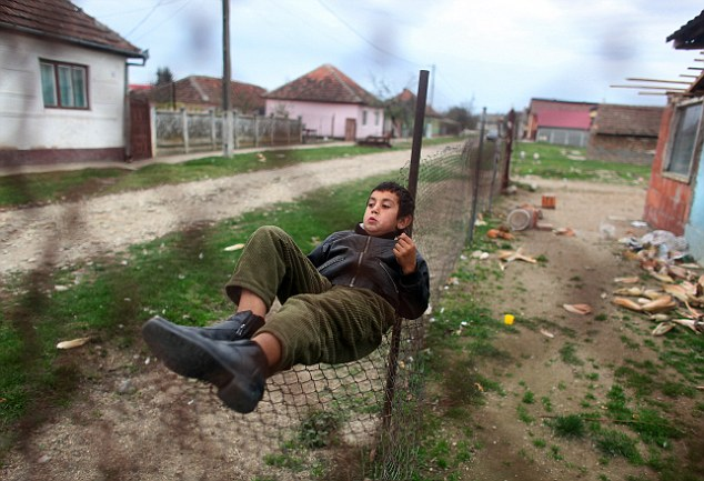 Handouts: The families in the village only receive £9 a month from the Romanian authorities for each of their children, which they say is not enough to raise them