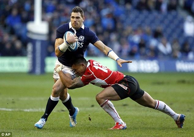 Making a break: Scotland's Sean Lamont is tackled by Japan's Male Sau