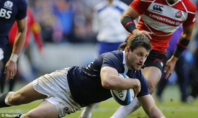 Five points: Scotland's Tommy Seymour goes over to score a try