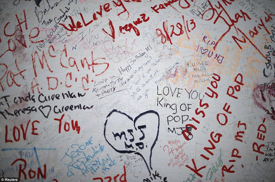 Outpouring of love: Messages, written by fans of singer Michael Jackson, are seen on a sign in front of his childhood home