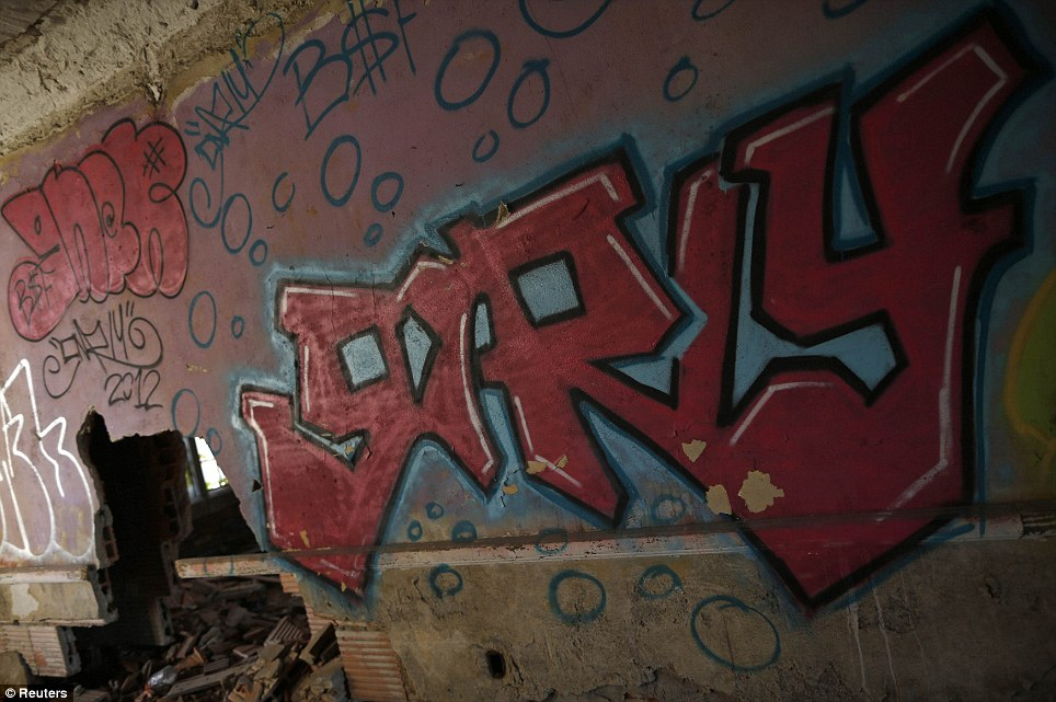 Writing on the wall: Graffiti is seen inside the abandoned and heavily damaged City Methodist Church in Gary