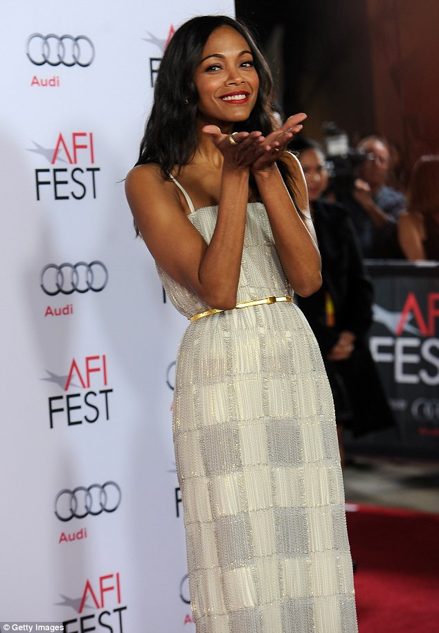 Romance on the brain: Zoe Saldana was in a playful mood as she blew kisses on the red carpet at the screening of her latest movie Out of the Furnace on Saturday