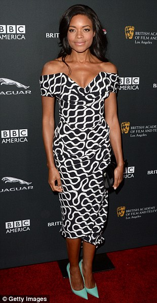 So chic: Naomie Harris wore a monochrome off-the-shoulder Vivienne Westwood dress while Poppy opted for a more gothic gown by Marios Schwab