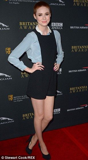 Too cool: Karen went against the norm of wearing a dress on the red carpet to show off her legs in the short outfit completed with a pale blue blouse with a white collar