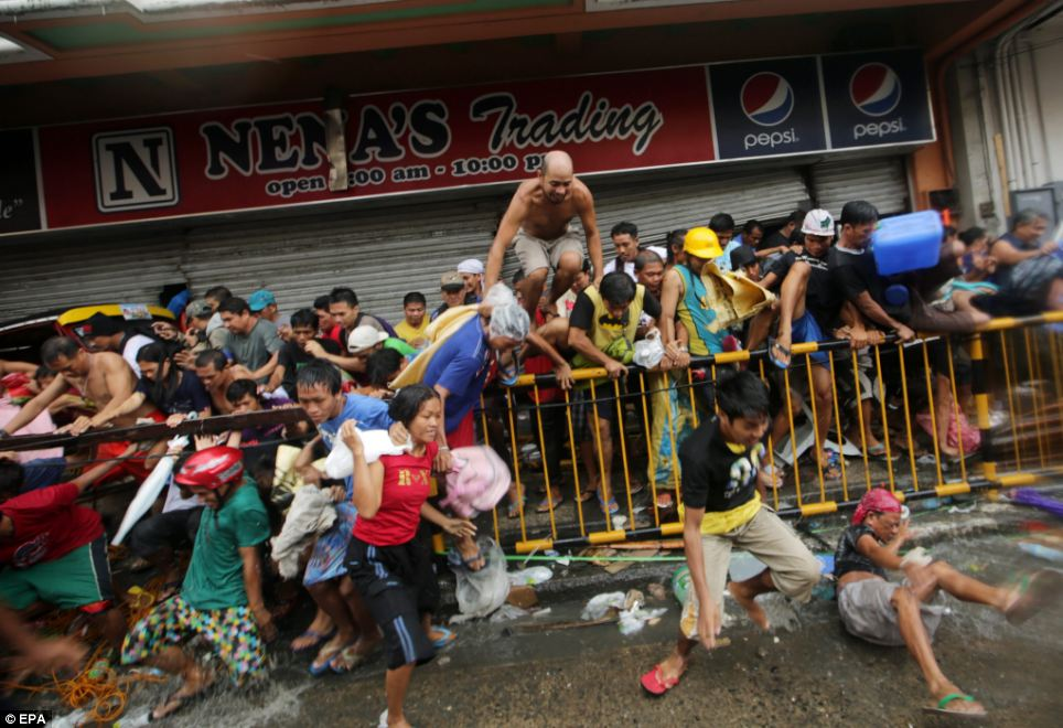 Survivors in Tacloban told reporters they are so desperate for food that they have been forced to loot shops and steal from the dead