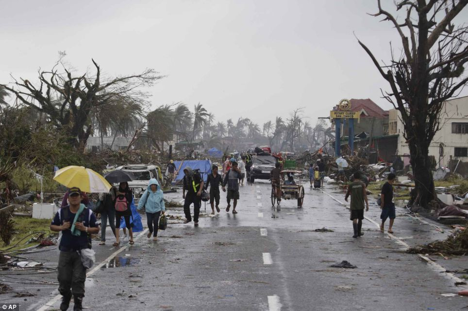 More than 330,900 people were displaced and 4.3million 'affected' by the typhoon in 36 provinces, the U.N. has said