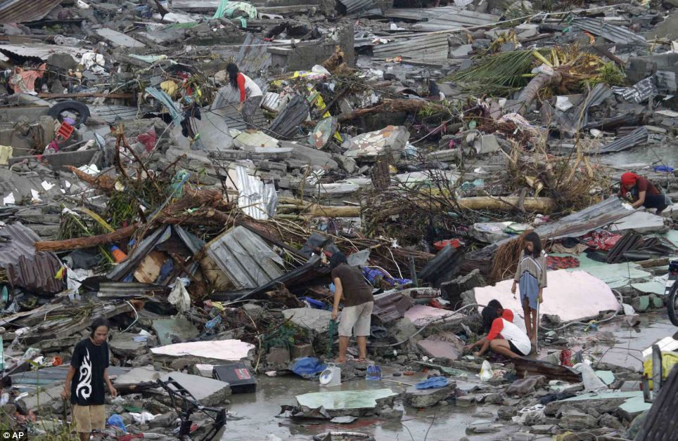 Residents try to salvage belongings in Tacloban city, Leyte province.