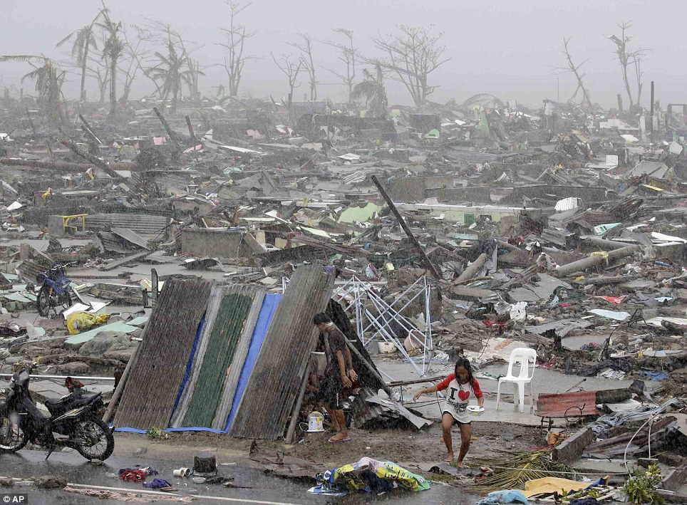 Trail of destruction: Those who escaped the awesome power of Haiyan now face a grim battle to rebuild their lives among the sprawling wreckages