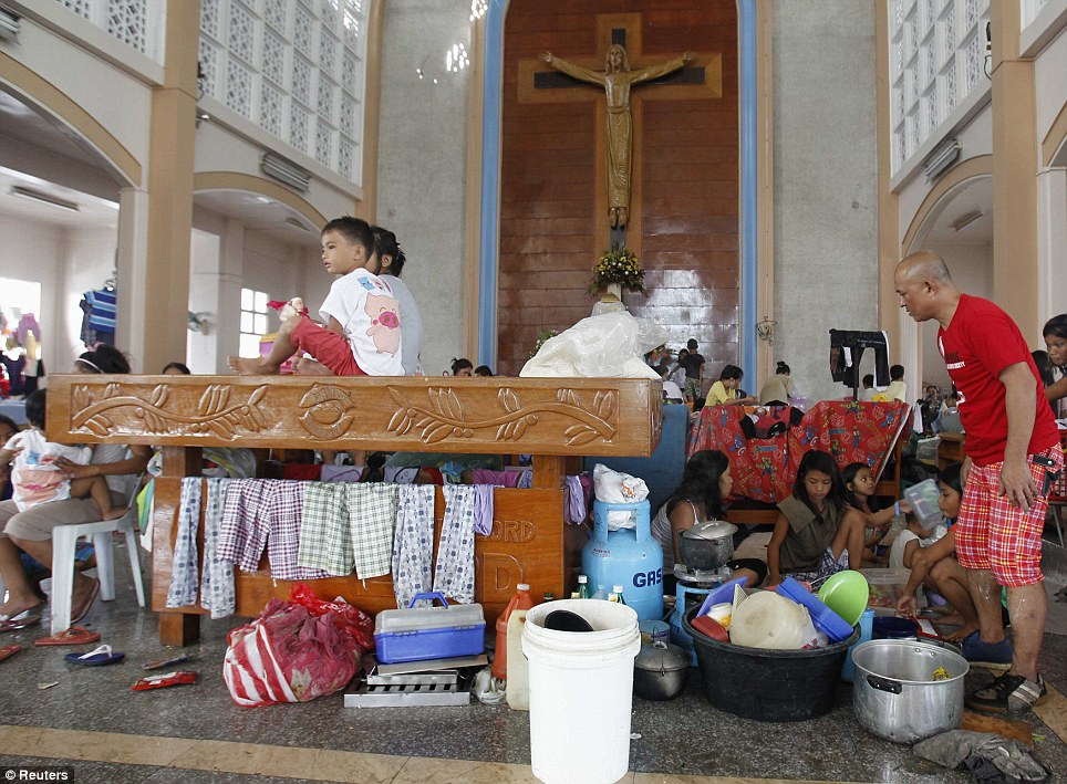 Holy house: Churches in the storm torn city have become temporary aid centres offering washing facilities and handing out emergency food supplies