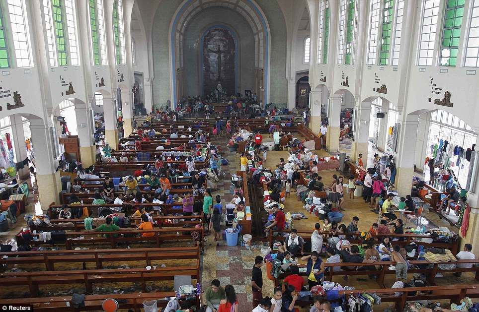 Shelter from the storm: While the Catholic church in Tacloban has welcomed victims, many buildings have been broken into by desperate looters