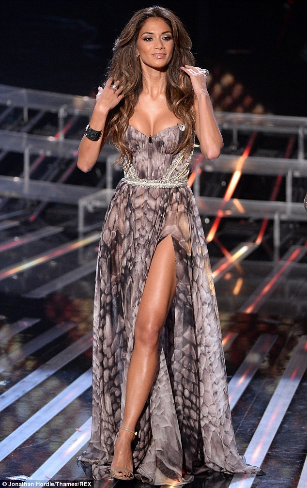 She's definitely got The X Factor: Nicole Scherzinger broke the golden sartorial rule of flashing both cleavage and leg as she took to the X Factor stage on Sunday night - but managed to pull it off with aplomb