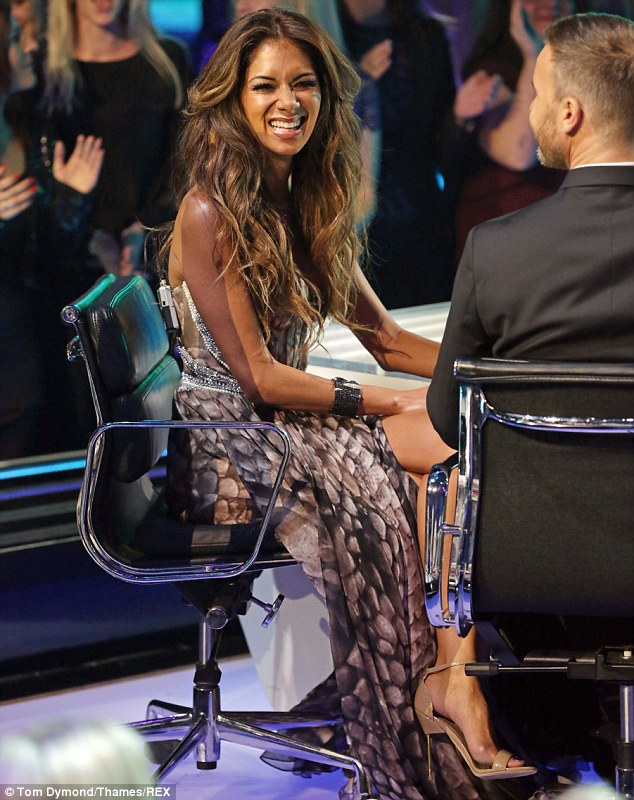 Happy days: Although Nicole was all smiles as she took to the X Factor stage alongside Sharon and fellow panellists Gary Barlow and Louis Walsh, it was a disastrous night for the mentor