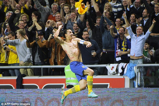National hero: Ibrahimovic whips his shirt off to celebrate his fourth goal against England in November 2012