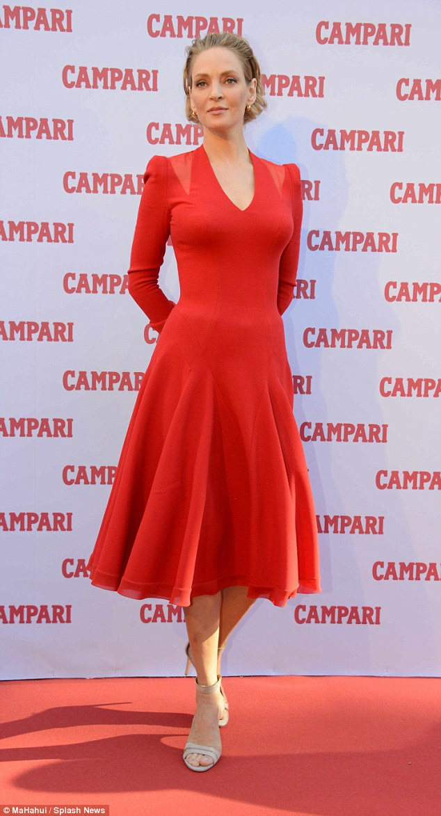 Red carpet ready! Uma wore another red dress for the launch of her Campari calendar in Milan