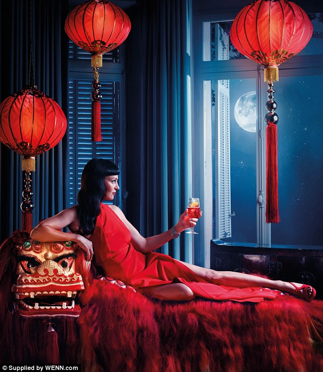 In a look somewhat reminiscent of her Oscar nominated role in Pulp Fiction, Uma peers wantonly at a Chinese moon