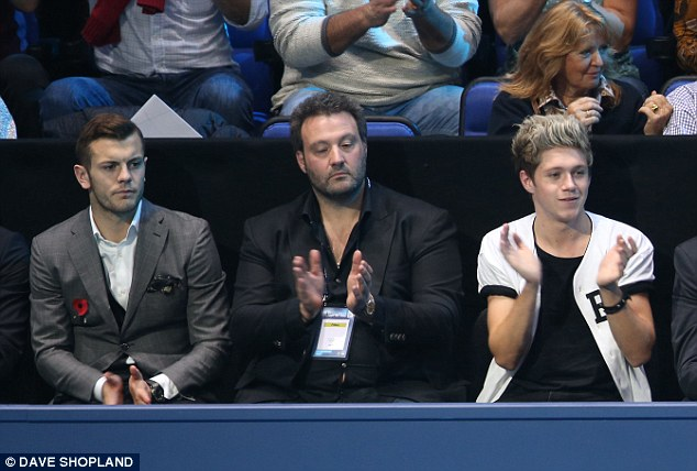 Interested spectators: Arsenal midfielder Jack Wilshere (left) and One Direction's Niall Horan (right) watch the action at the O2 Arena