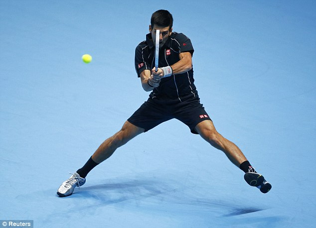 Foused: Djokovic keeps his eye on the ball as he hits a double-handed backhand