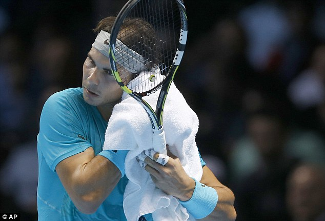 Feeling the heat: Nadal wipes the sweat from his brow during a pulsating first set