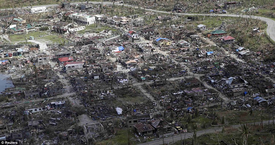 A battered town in Samar province in central Philippines. Dazed survivors  begged for help and scavenged for food, water and medicine on Monday, threatening to overwhelm military and rescue resources