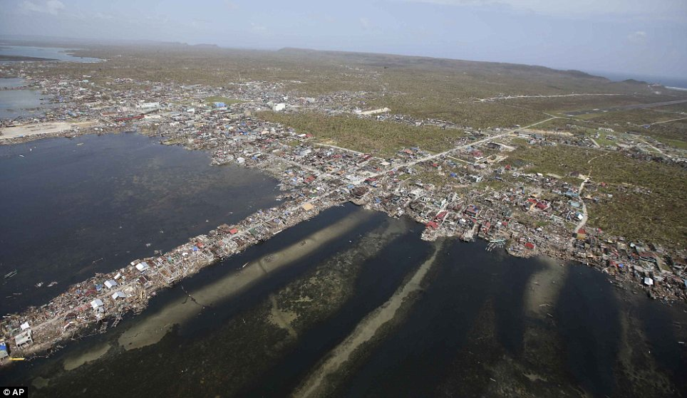 An aerial shot from a Philippine Air Force helicopter shows the devastation on Monday of the first landfall by typhoon Haiyan in Guiuan, Eastern Samar province, central Philippines