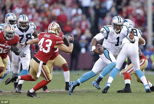 Elusive: Carolina Panthers quarterback Cam Newton takes off for a run