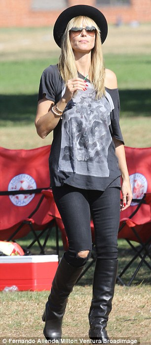 Grass catwalk: No doubt Heidi's figure is the envy of the other soccer mums