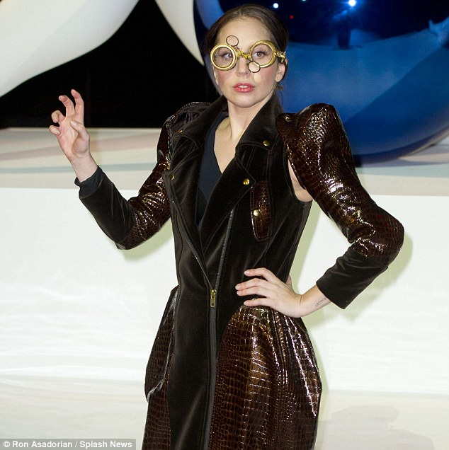Jules Verne would be proud: Gaga met photographers donning her clockwork bronze goggles