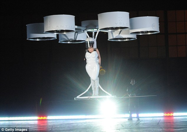 We have liftoff! The Applause singer takes to the skies in the futuristic flying dress