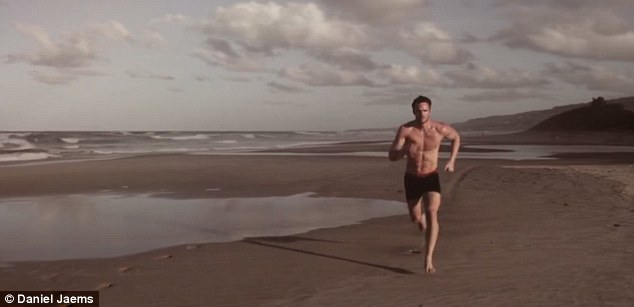 Better than Baywatch: Thom, who now has his sights set on acting, sprints across the sun-drenched beach