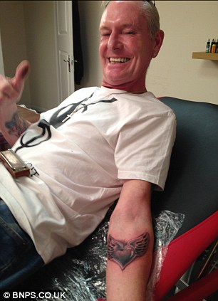 Gazza shows off his new tattoo.