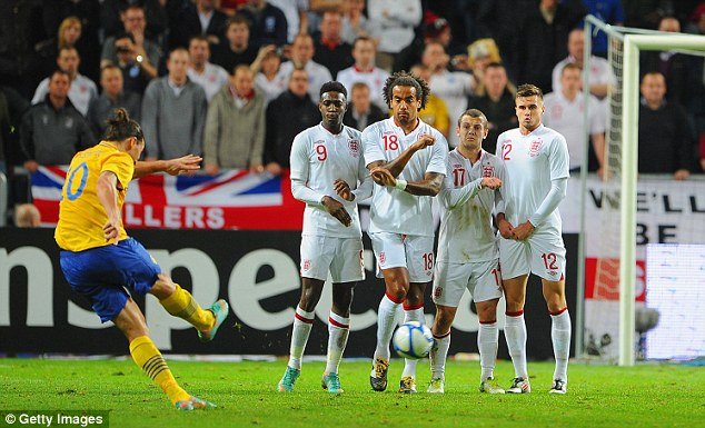 That's the hat-trick: The Swede crashes home his third goal against England direct from a free-kick late last year