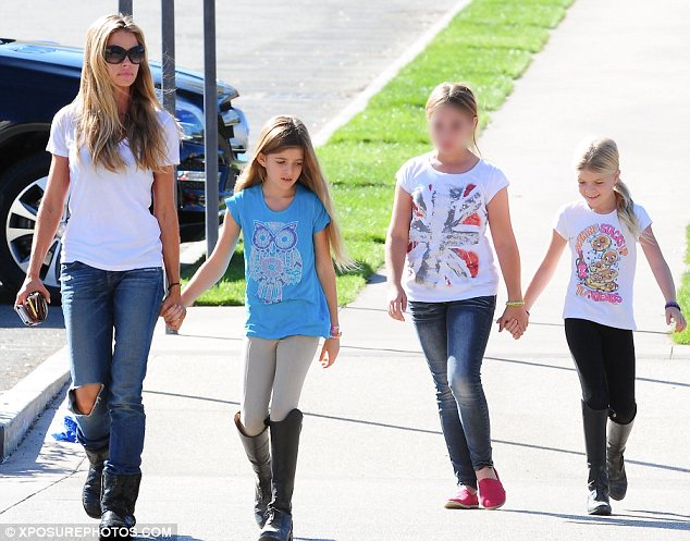 Mother/daughter day out: Denise Richards took her daughters Sam and Lola and a friend horse riding and for frozen yoghurt in Los Angeles on Monday
