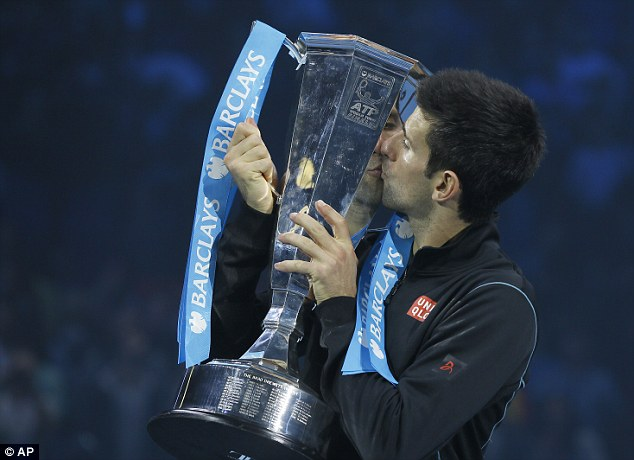 Sealed with a kiss: Djokovic shows his latest trophy some affection