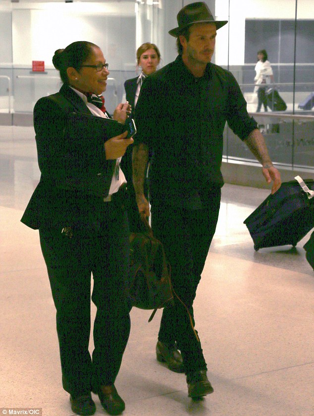 Hat trick: David Beckham arrived in Miami, Florida on Sunday in a dark blue hat, matching shirt and jeans