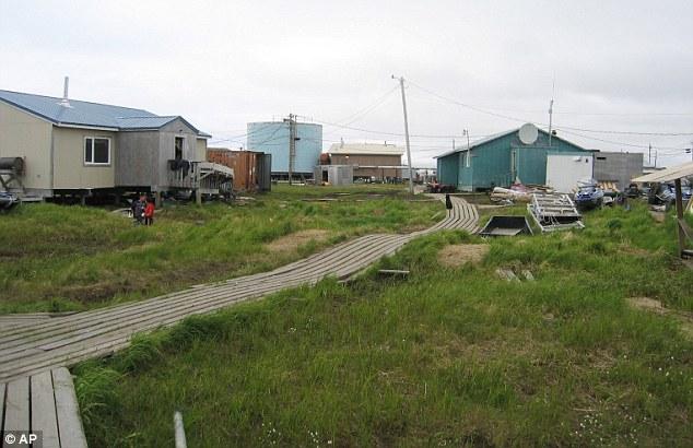 Wooden boards connect houses in Newtok, Alaska - the flood-prone village near Alaska's storm-battered coast