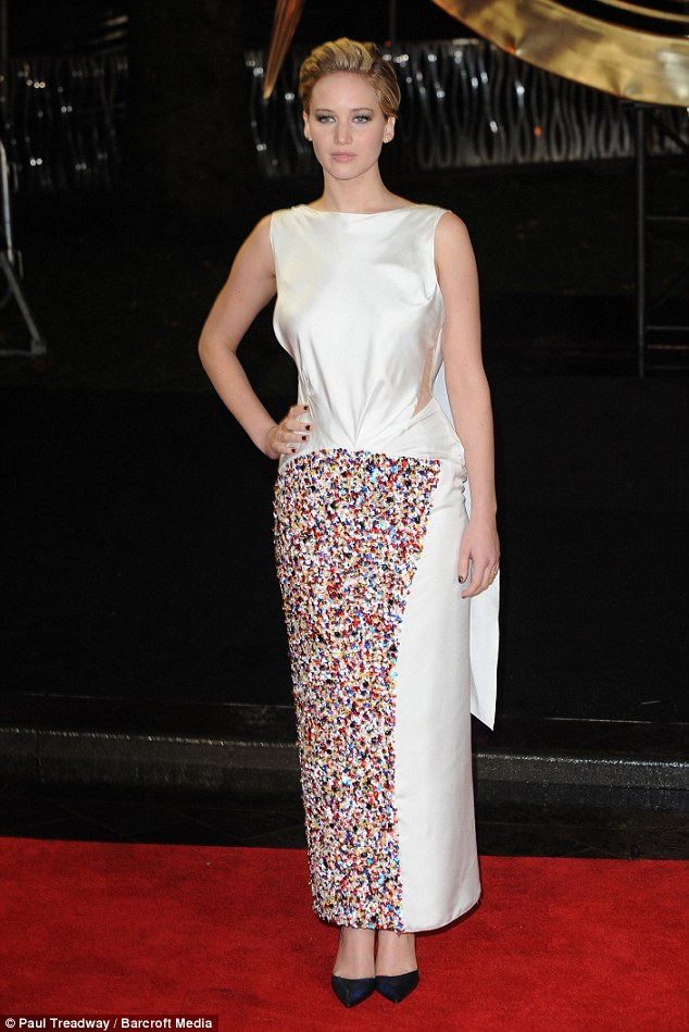 Smarties attack: Jennifer's dress was certainly elegant, its generous cut did little to accentuate her youthful figure, while the embellished pattern resembled an explosion in a Smarties factory
