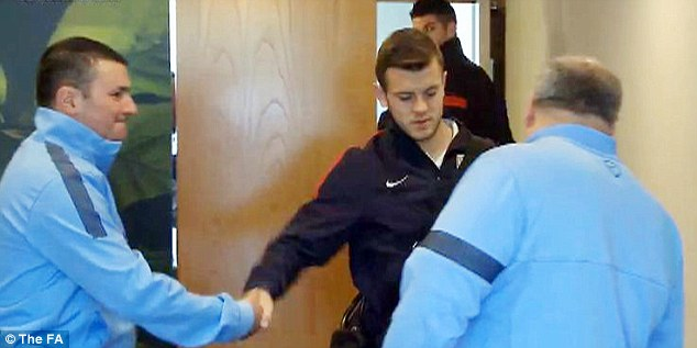 At home: Jack Wilshere jaunts in to meet his England team-mates and backroom staff