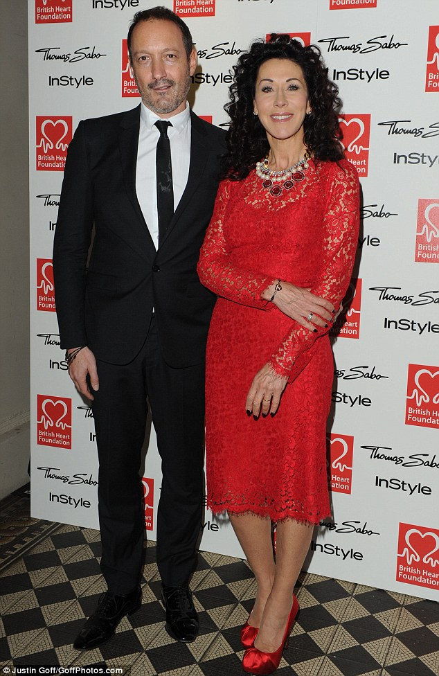 Scarlet woman: Helen David looks stunning in red lace as she poses with Julian Vogel