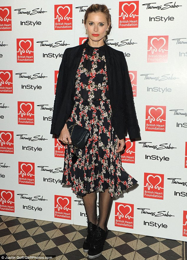 Floral fancy: Laura Bailey draped a black blazer over her flowery tea dress