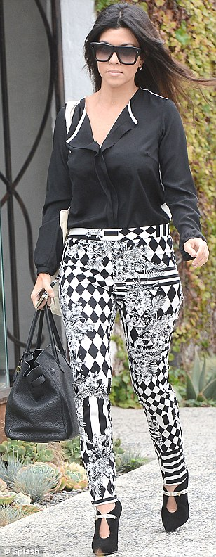 Monochrome look: Kourtney certainly stood out in her eye-catching outfit