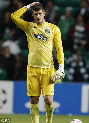 Celtic's Fraser Forster looks dejected at full time during the UEFA Champions League match versus Barcelona at the Celtic Park