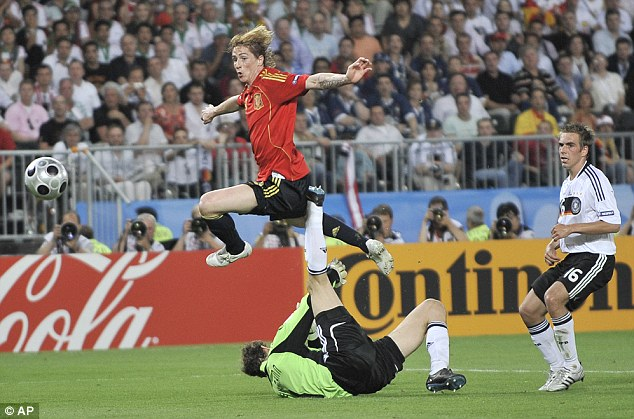 Traditional: Fernando Torres settles the Euro 2008 final against Germany in red shirt and blue shorts