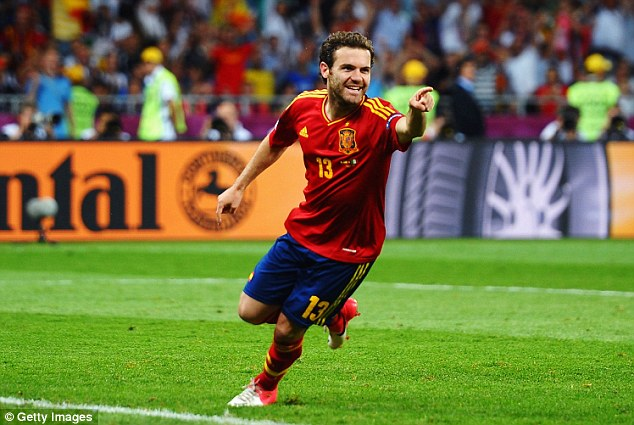 Three in a row: Juan Mata celebrates after scoring Spain's fourth goal in the Euro 2012 final