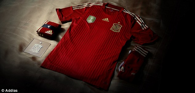 The shirt fits: Spain's new kit features a traditional red shirt, but has ditched the usual blue shorts and socks