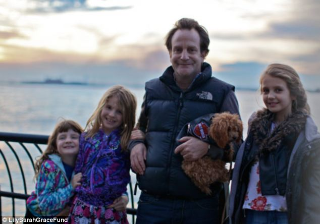 Ripped apart: The girls are pictured with their father Matthew Badger, who was also invited to the house in Connecticut for Christmas but stayed in Manhattan instead. He has set up a fund in the girls' names