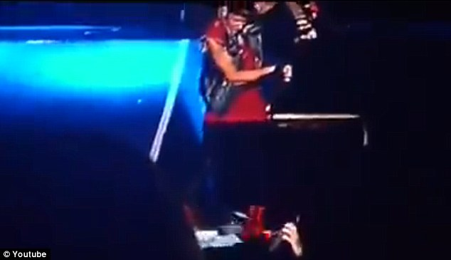 Disrespectful: Justin kicked the flags, which were later revealed to be tops, off stage