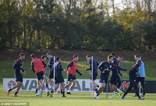 Ready to go: England's players train at London Colney on Wednesday