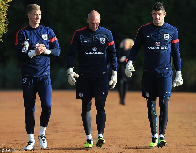Stiff competition: Regular goalkeeper Joe Hart (left) looks set to be replaced by Fraser Forster (right) on Friday